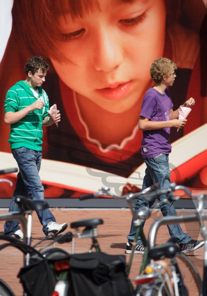 Two boys eating chips in front of special background