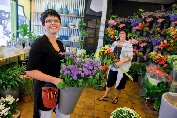 Girl from a flowershop shows her flowers