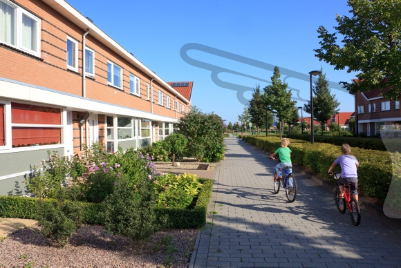Children cycling in their neighbourhood on a sunny day