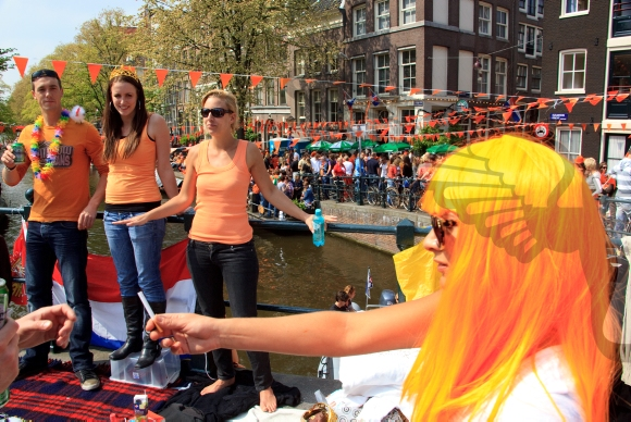 Girl with an orange wig during the celebration of Queensday.