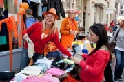 Celebration of Queensday. Woman is selling second-hand clothes.