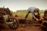 Netherlands, Barger-Compascuum. Man digging up peat at 'Veenpark' museum. This scene reminds on a painted scene by van Gogh who stayed in this area for 3 months. Veenpark shows the history of the 'peat' area at the beginning of the 20sth century. Peat