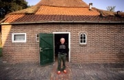 Netherlands, Gees. Farmer in front of his farm house. Small village scene in Gees very near Zweelo.