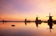 Sunset over a solitairy rower on the Zaan river at the Zaanse Schans