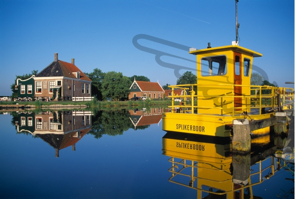 Yellow ferryboat on a canal