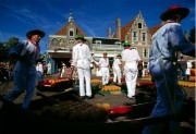 Men loading cheese on their 'stretchers' at the cheese market of Edam