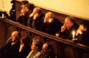 People in a church listening at