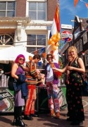 Cheerful young people celebrating Queens day
