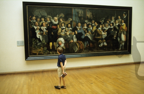 Boy looking at a painting