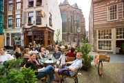 people sitting on a terrace in the historic center of Nijmegen