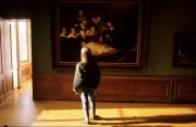 Girl looking at a famous painting by Rembrandt