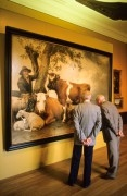 Two old men looking at a famous painting called 'the bull'