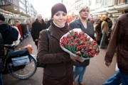 Portrait of a muslim girl holding a bouquet of red tulips