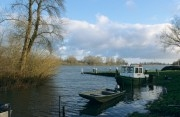 Patrol boat of the ranger in the nature area Biesbosch